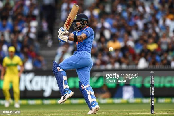 India's Virat Kohli bats during the third one-day international cricket match between Australia and India at the Melbourne Cricket Ground in...