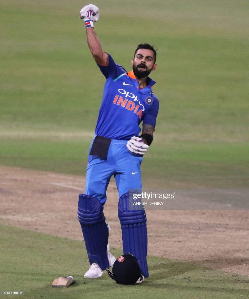 India's Virat Kohli celebrates after scoring a century (100 runs) during the first One Day International (ODI) cricket match between South Africa and India at Kingsmead Cricket Ground on February 1, 2018 in Durban. /