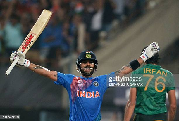 India's Virat Kohli celebrates after victory in the World T20 cricket tournament match between India and Pakistan at The Eden Gardens Cricket Stadium...