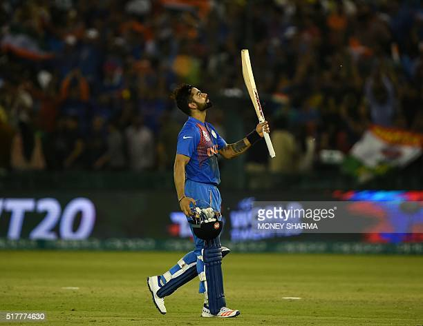 India's Virat Kohli celebrates after victory in the World T20 cricket tournament match between India and Australia at The Punjab Cricket Stadium...