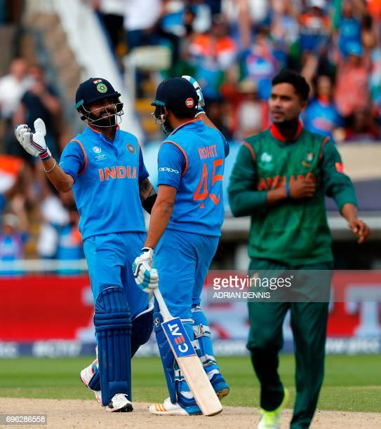 India's Virat Kohli celebrates with Rohit Sharm after hitting the winning runs in the ICC Champions Trophy semifinal cricket match between India and...