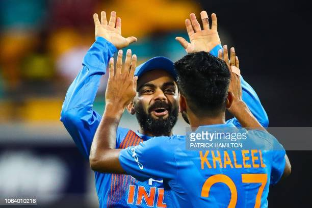 India's Virat Kohli congratulates teammate Khaleel Ahmed on dismissing Australia's batsman D'Arcy Short during the T20 international cricket match...