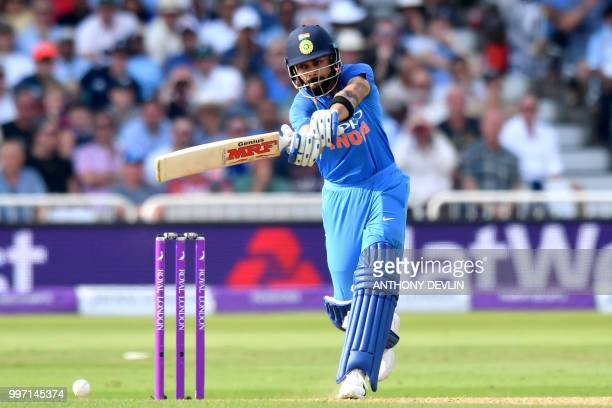India's Virat Kohli hits a shot during the One Day International cricket match between England and India at Trent Bridge in Nottingham central...