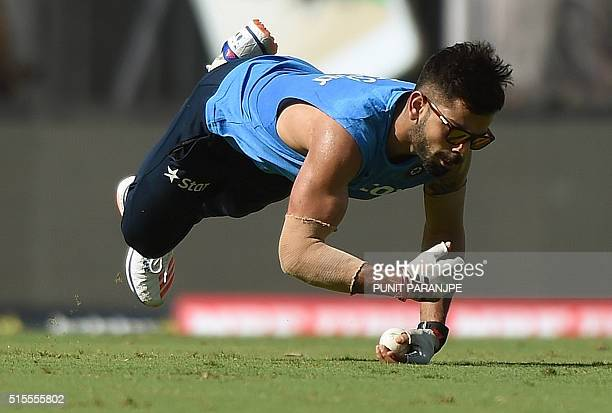 India's Virat Kohli jumps to catch a ball during the training session at The Vidarbha Cricket Association Stadium in Nagpur on March 14 2016 India...