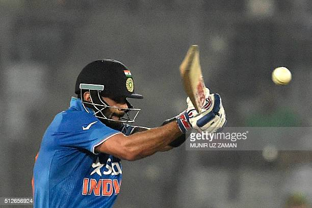 India's Virat Kohli plays a shot during the Asia Cup T20 cricket tournament match between India and Pakistan at the ShereBangla National Cricket...