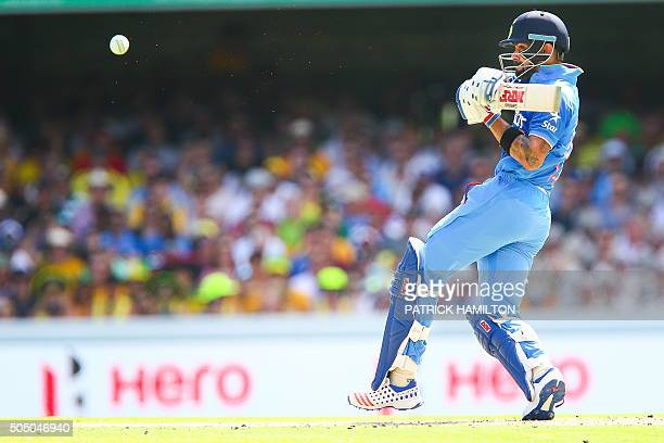TOPSHOT India's Virat Kohli plays a shot during the oneday international cricket match between India and Australia in Brisbane on January 15 2016 /...