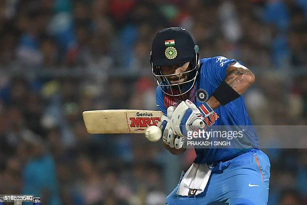 India's Virat Kohli plays a shot during the World T20 cricket tournament match between India and Pakistan at the Eden Gardens cricket stadium in...
