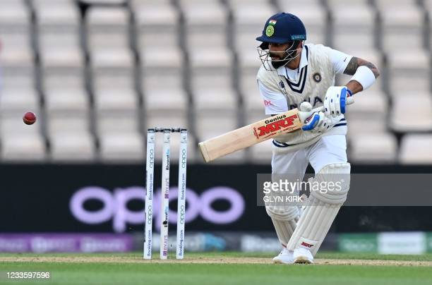 India's Virat Kohli plays a shot on the fifth day of the ICC World Test Championship Final between New Zealand and India at the Ageas Bowl in...