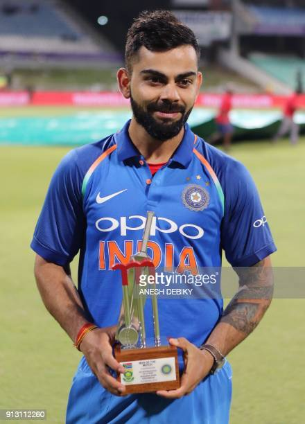India's Virat Kohli poses with his trophy for Man of the Match during the first One Day International cricket match between South Africa and India at...