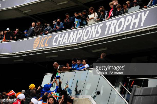 India's Virat Kohli signs autographs as rain delays play during the ICC Champions Trophy Final at Edgbaston Birmingham