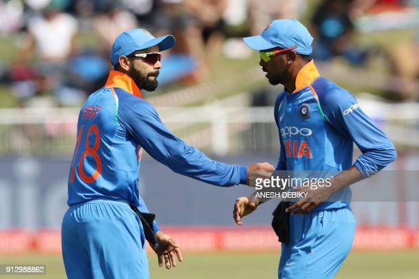 India's Virat Kohli speaks with Hardik Pandya during the first One Day International cricket match between South Africa and India at Kingsmead...