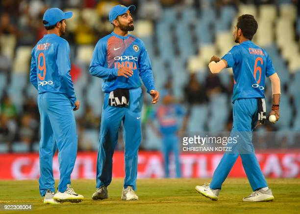 India's Virat Kohli speaks with India's Yuzvendra Chahal during the second T20I cricket match between South Africa and India at Super Sport Park...