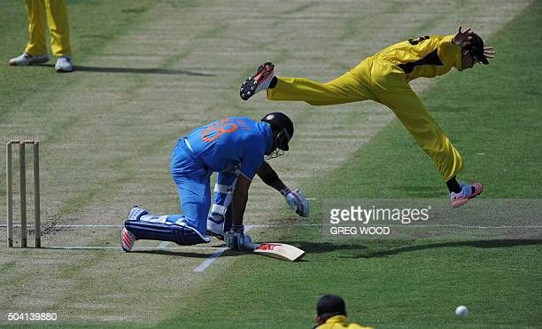 TOPSHOT India's Virat Kohli stretches to make his crease as fieldsman Jake Carder jumps to avoid contact during the oneday cricket match between...