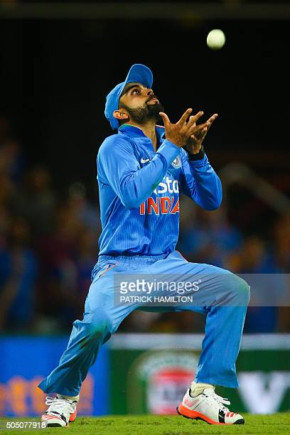India's Virat Kohli takes a catch to dismiss Shaun Marsh during the oneday international cricket match between India and Australia in Brisbane on...