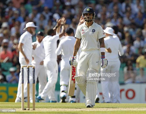 Indias Virat Kohli walks back to the pavilion after getting out for 20 runs during play on the third day of the fifth cricket Test match between...