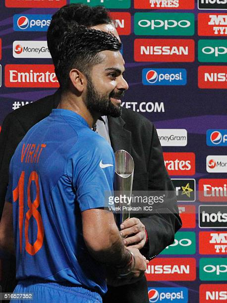 India's Virat Kohli with the man of the match trophy during the ICC World Twenty20 India 2016 match betweenPakistan and India at Eden Gardens on...