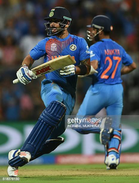 India's Virat Kohliand Ajinkya Rahane run between the wickets during the World T20 semifinal match between India and West Indies at The Wankhede...
