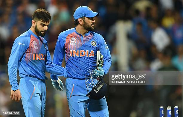 India's Virat Kohliand captain Mahendra Singh Dhoni look on after defeat in the World T20 cricket tournament second semifinal match between India and...
