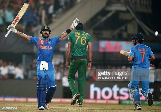 India's Virat Kohlicelebrates with captain Mahendra Singh Dhoniafter victory in the World T20 cricket tournament match between India and Pakistan at...