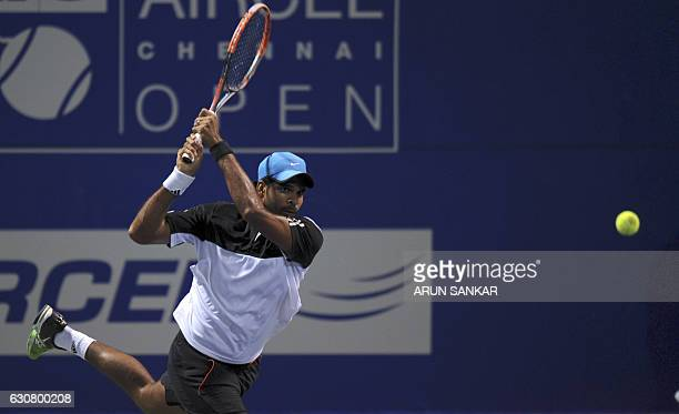 India's Vishnu Vardhan returns the ball to Sweden's Johan burnstrom and Andreas Siljestrom during the first round of the doubles match of the Chennai...