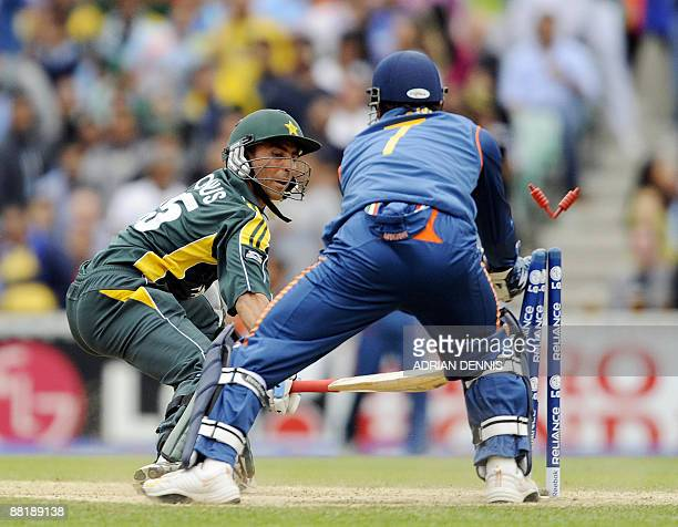 India's wicket keeper Mahendra Singh Dhoni stumps Pakistan's Younis Khan during an ICC World Twenty20 warm-up match at the Oval in London June 3,...