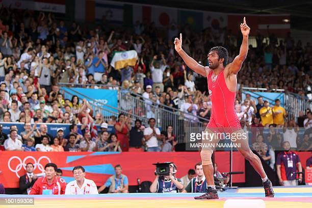 India's Yogeshwar Dutt celebrates after defeating North Korea's Ri Jong Myong in their Men's 60kg Freestyle bronze medal match on August 11 2012...