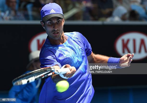 India's Yuki Bhambri hits a return against Britain's Andy Murray during their men's singles match on day one of the 2015 Australian Open tennis...