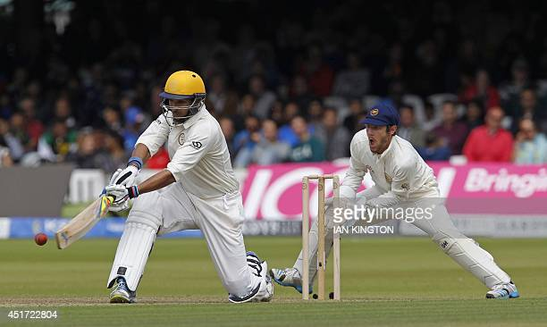 Indias Yuvraj Singh hits a shot playing for the Rest of the World team, watched by Englands Chris Read during the Lord's bicentenary match between...
