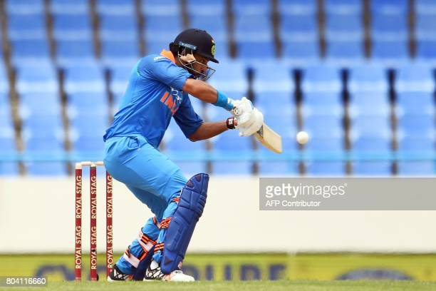 India's Yuvraj Singh plays a shot during the third One Day International match between West Indies and India at the Sir Vivian Richards Cricket...