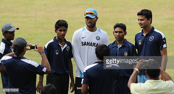 India's Yuvraj Singh poses with ball boys for a photograph during a training session at The Jawaharlal Nehru Cricket Ground in Margao Goa on October...