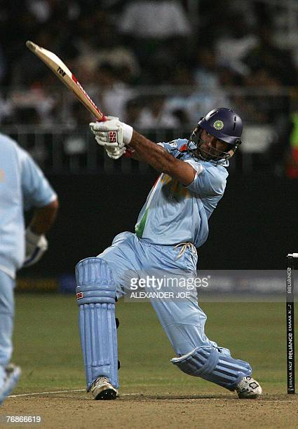 India's Yuvraj Singh slams his 6th six in one over off the ball of England's Stuart Broad at Kingsmead Stadium in Durban 19 September 2007 during the...