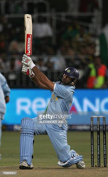India's Yuvraj Singh slams his sixth six in one over off the ball of England's Stuart Broad at Kingsmead Stadium in Durban 19 September 2007 during...