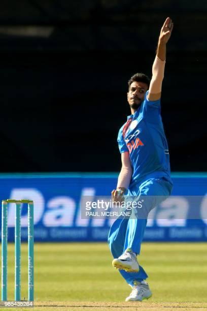 India's Yuzvendra Chahal bowls during the Twenty20 International cricket match between Ireland and India at Malahide cricket club in Dublin on June...