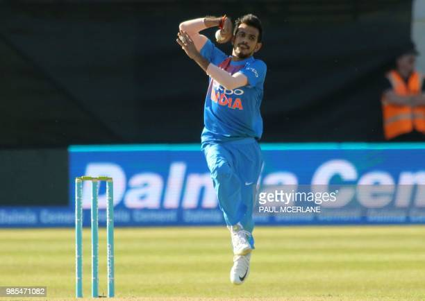 India's Yuzvendra Chahal bowls during the Twenty20 International cricket match between Ireland and India at Malahide cricket club in Dublin on June...