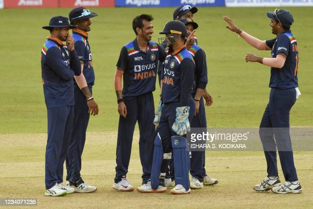 India's Yuzvendra Chahal celebrates with his teammate after the dismissal of Sri Lanka's cricket captain Dasun Shanaka during the second one-day...