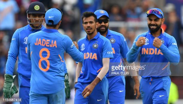 India's Yuzvendra Chahal celebrates with teammates after the dismissal of New Zealand's captain Kane Williamson during the 2019 Cricket World Cup...