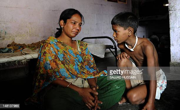 IndiasocietychildrenabuserapeFEATURE by Ammu Kannampilly This photo taken on June 11 2012 shows Pooja the mother of an 11yearold girl who died in a...