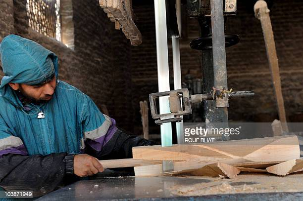 IndiaunrestKashmireconomycricketFOCUS by Izhar Wani This photo taken on September 1 2010 shows a craftsman shaping a cricket bat made from willow...