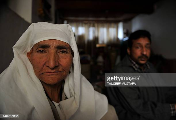 India-unrest-Kashmir-rights,FEATURE by Izhar Wani In a picture taken on October 10 Syed Maqbool Shah and his mother Zoona Bugum are seen at his home...