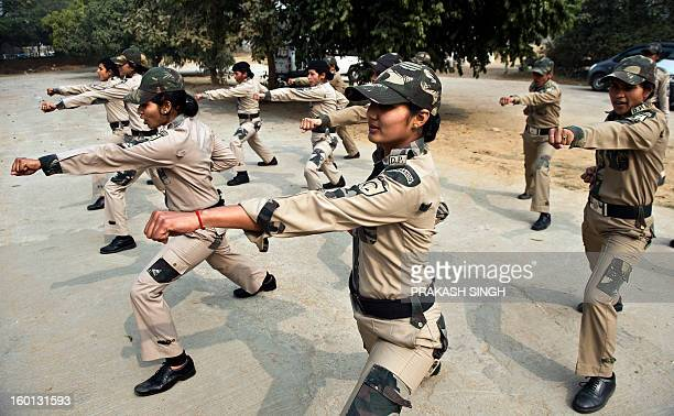 IndiawomencrimepoliceFEATURE by Ammu Kannampilly This picture taken on January 16 shows Delhi Police women commandos doing warm up excercises in New...