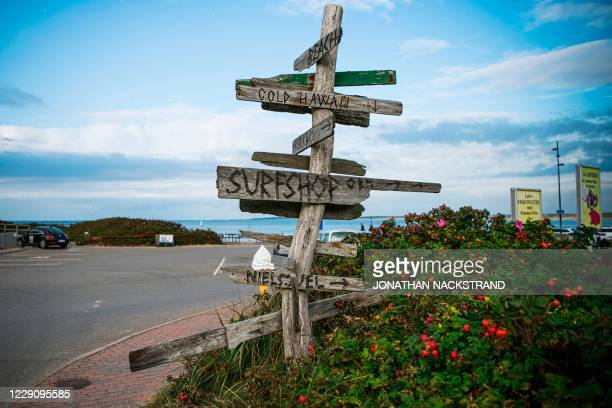 Indication signs are pictured on September 30, 2020 in Klitmoller, Denmark. - On Denmark's rugged western coast, far from paradise islands in the...