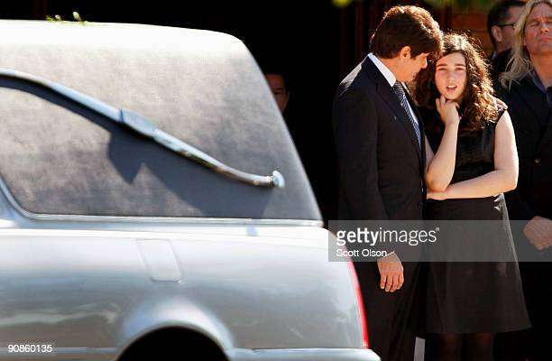 Indicted former Illinois Governor Rod Blagojevich and daughter Amy watch as the funeral procession for one of his former top fundraisers and advisors...