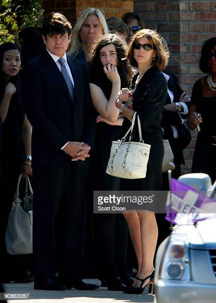 Indicted former Illinois Governor Rod Blagojevich his wife Patti and daughter Amy watch as the funeral procession for one of his former top...