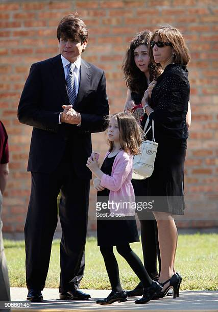 Indicted former Illinois Governor Rod Blagojevich his wife Patti and their daughters Amy and Annie watch as the funeral procession for one of his...