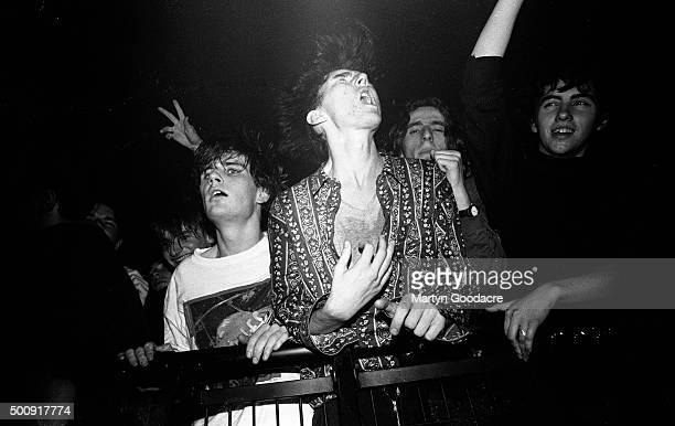 Indie fans absorbed in the music in the front rows of the crowd, watching the Soup Dragons perform in Rennes, France, 1990.