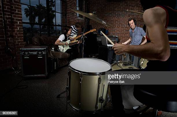 indie rock band - garage band stock photos and pictures