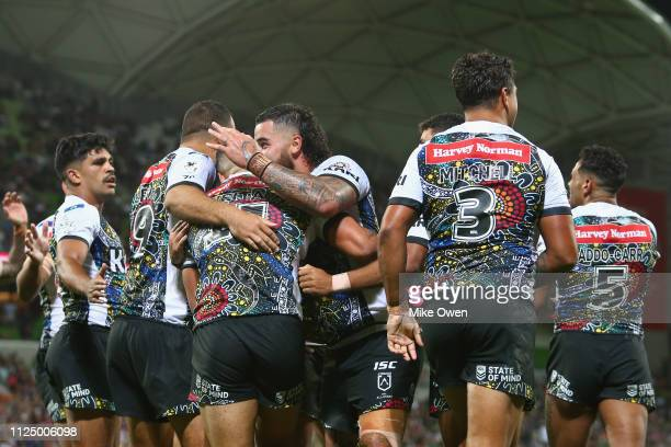 Indigenous All Stars players celebrate after scoring a try during the NRL exhibition match between the Indigenous All Stars and the Maori All Stars...