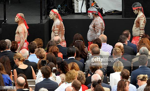 Indigenous Australians walk towards the stage to perform in front of the visiting Denmark's Crown Prince Frederik and his Australian wife Crown...