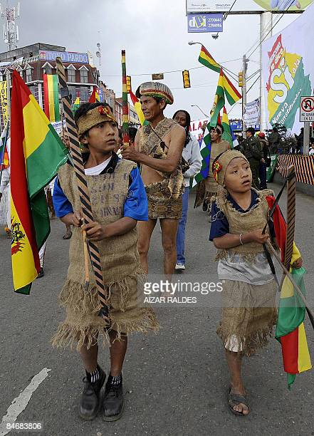 Indigenous Ayorea Bolivians participate in a parade during an enactment ceremony for the new constitution in El Alto 12 kms from La Paz on February 7...