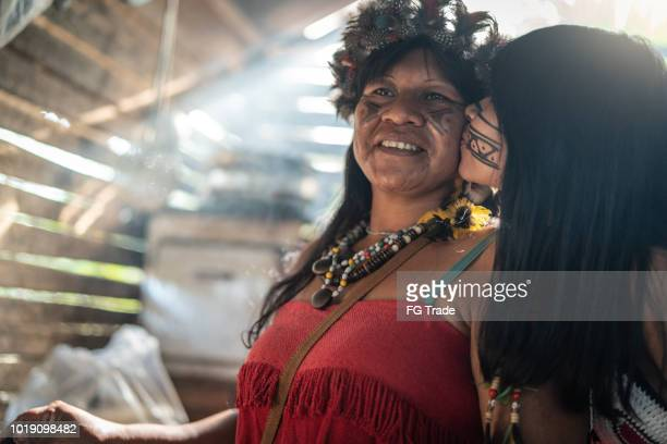 indigenous brazilian mother and daughter portrait, from tupi guarani ethnicity, in a hut - mato grosso do sul state stock pictures, royalty-free photos & images